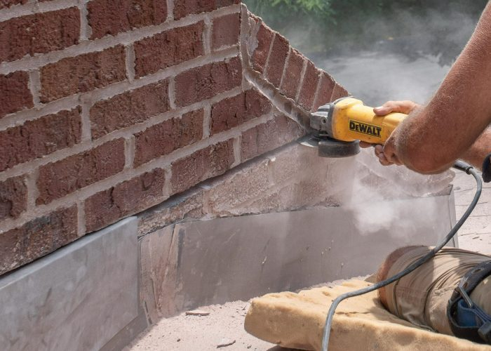 Grinding out mortar counter flashing installation